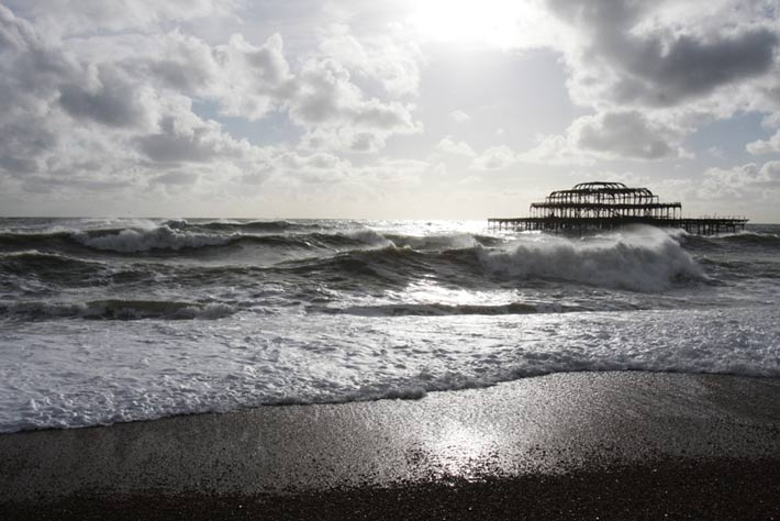 Surfing Brighton west pier
